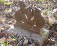 Fragment ułamanego zdobionego żewliwnego krzyża