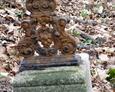 Fragment zdobionego żeliwnego krzyża