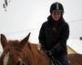 Patrycja siedzi na koniu