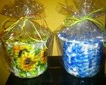 Koszyczki słoneczniki i kwiatki niebieskie wys 14cm, obwód 52cm. Cena 20 zł